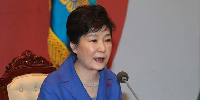 South Korean President Park Geun-hye speaks during an emergency Cabinet meeting at the presidential office in Seoul after the impeachment vote.