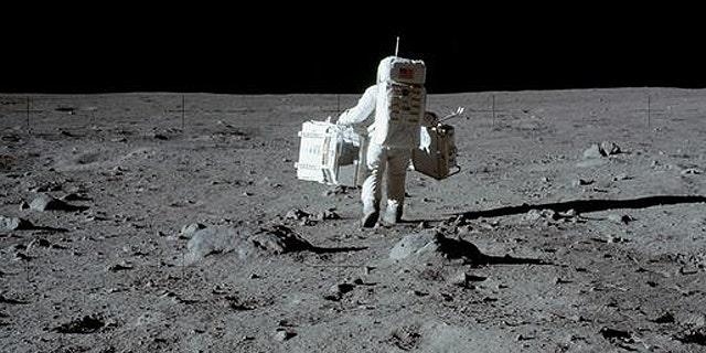 Apollo astronaut Buzz Aldrin collects moon rocks in 1969.