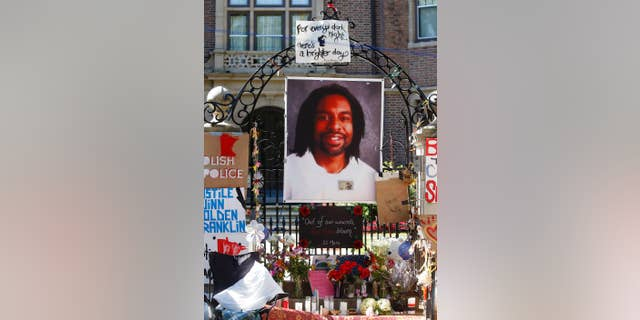 A memorial including a photo of Philando Castile adorns the gate to the Minnesota governor's residence where protesters demonstrated in St. Paul, July 25, 2016. (Associated Press)