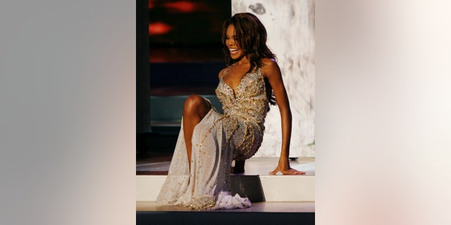 Crystle Stewart of the U.S. falls during the evening gown competition of the Miss Universe 2008 annual pageant held this year in the central Vietnam resort city Nha Trang, July 14, 2008.
