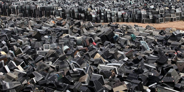 Aug. 26, 2013: Discarded television sets pile up in a scrap yard awaiting recycling in Zhuzhou city in south China's Hunan province. China's recycling industry has boomed over the past 20 years. Its manufacturers needed the metal, paper and plastic and Beijing was willing to tolerate the environmental cost.