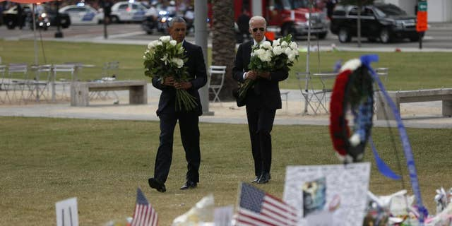 President Obama and Vice President Biden arrive to place flowers at a memorial in Orlando Thursday.