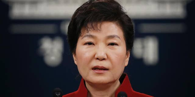"""FILE - In this Jan. 13, 2016, file photo, South Korean President Park Geun-hye addresses the nation during her news conference at the Presidential Blue House in Seoul, South Korea. Upping its rhetoric a notch, North Korea warned Saturday, March 26, 2016, that it will attack Seoul's presidential palace unless it receives an apology from South Korean President Park for """"treason."""" The warning is the latest threat against Washington and Seoul over joint U.S.-South Korean military drills now underway that the North sees as a dress rehearsal for invasion. (Kim Hong-ji/Pool Photo via AP, File)"""
