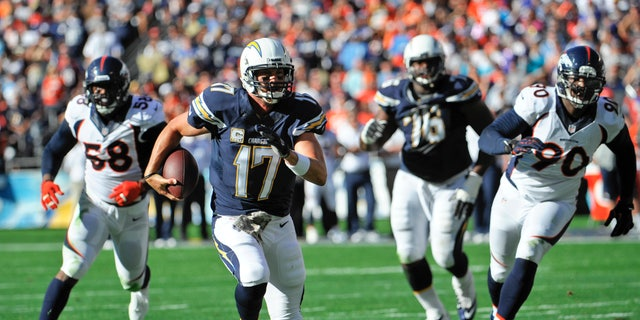 San Diego Chargers quarterback Philip Rivers scrambles away from the Denver Broncos defense in the first quarter of an NFL football game Sunday Nov. 10, 2013 in San Diego. (AP Photo/Denis Poroy)