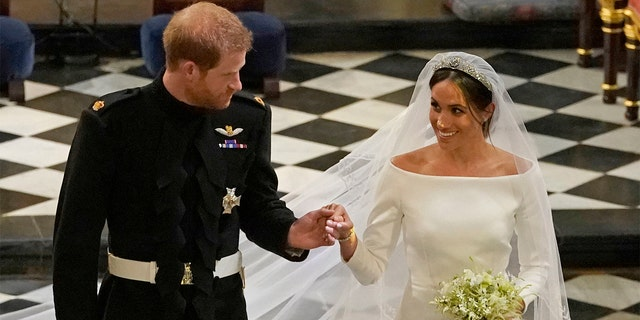 Britain's Prince Harry and Meghan Markle leave after their wedding ceremony at St. George's Chapel in Windsor Castle in Windsor, near London, England on Saturday.