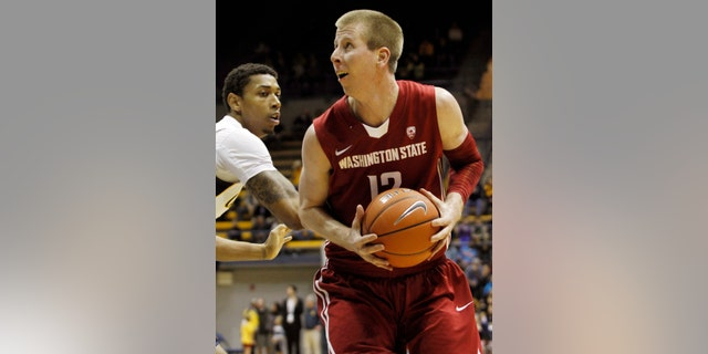 Washington State's Brock Motom, right, looks to shoot as California's Richard Solomon defends during the first half of an NCAA college basketball game, Saturday, Jan.12, 2013 in Berkeley, Calif. (AP Photo/George Nikitin)
