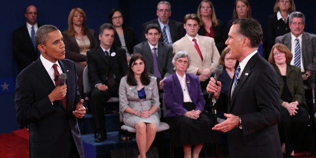 Oct. 16, 2012: President Barack Obama and Republican presidential nominee Mitt Romney confront each other during the second presidential debate at Hofstra University in Hempstead, N.Y.