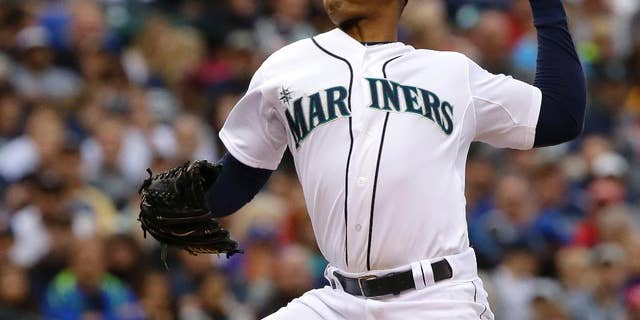 Seattle Mariners starting pitcher Roenis Elias kicks throws against the Washington Nationals during the fourth inning of a baseball game, Saturday, Aug. 30, 2014, in Seattle. (AP Photo/Ted S. Warren)
