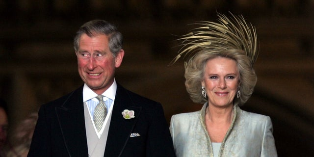 Britain's Prince Charles grins next to the Duchess of Cornwall after their marriage ceremony in 2005. The son of Queen Elizabeth II, he is the first in line for the throne.