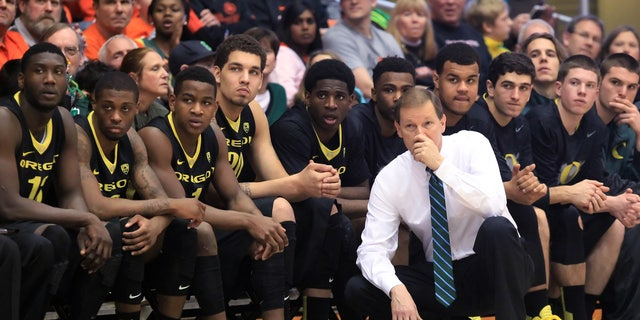 Oregon head coach Dana Altman and the bench watch as the Oregon State take a double-digit lead during an NCAA men's basketball game at Gill Coliseum in Corvallis, Ore. on Sunday, Jan. 19, 2014. Oregon lost 80-72 to Oregon State. (AP Photo/The Register-Guard, Brian Davies)