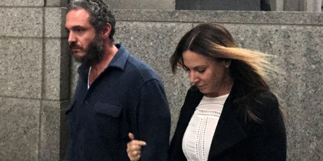 Joseph Meli and his wife exit U.S. Federal Court in Manhattan.