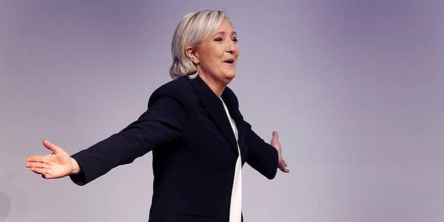 FILE - In this Saturday, Jan. 21, 2017 file photo, far-right leader and candidate for next spring presidential elections Marine le Pen from France celebrates after her speech at a meeting of European Nationalists in Koblenz, Germany. The European parliament is asking France's far-right leader Marine Le Pen to start repaying hundreds of thousands euros it says were wrongly paid to legislative aides. An EU parliament letter to le Pen published by Challenges magazine gives Tuesday as the deadline to begin repayment of about 300,000 euros ($322,000). (AP Photo/Michael Probst, File)