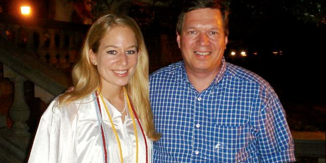 Natalee Holloway, 18, left stands with her father, Dave Holloway, in 2005.