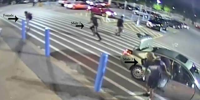 """Police said surveillance footage captured the female, who's now """"safe and unharmed,"""" escaping the vehicle and running away from a group of men, who seemingly forced her back into the car."""