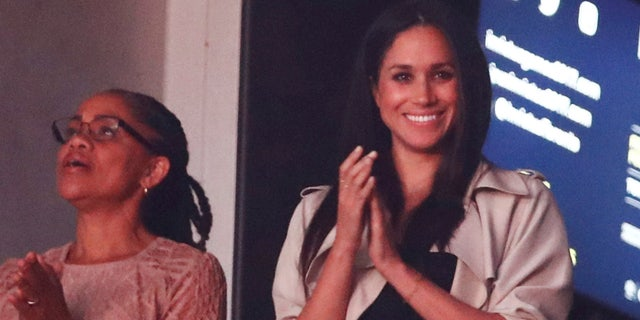 Meghan Markle, right, watches the closing ceremony for the Invictus Games with her mother.