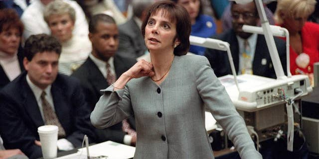 In this Sept. 29, 1995 photo, prosecutor Marcia Clark makes her closing arguments during the O.J. Simpson double-murder trial in Los Angeles, demonstrating on her own neck where a knife wound was sustained by murder victim Ronald Goldman in 1994.