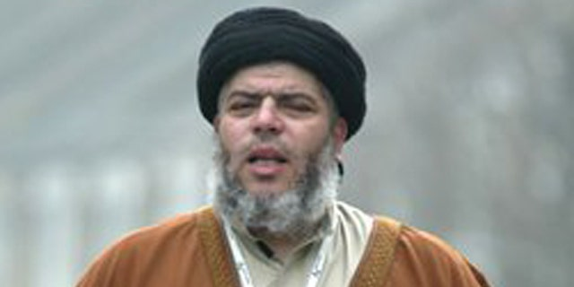 March 28, 2003: In this file photo, radical Muslim cleric Abu Hamza al-Masri prays in a street outside his Mosque in north London Europe's human rights court ruled on Tuesday, April 10, 2012 that it would be legal for Britain to extradite an Egyptian-born radical Muslim cleric and five other terror suspects to the United States.
