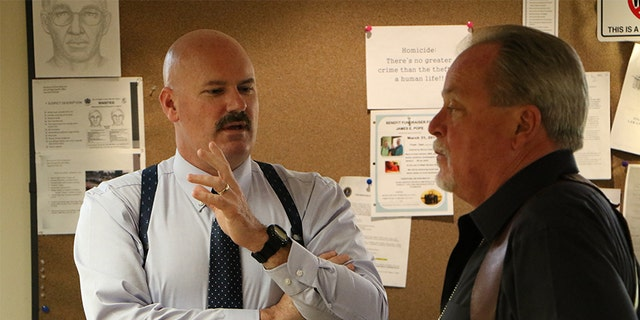 LT Tommy Potter (left) with investigator Randy Patrick.