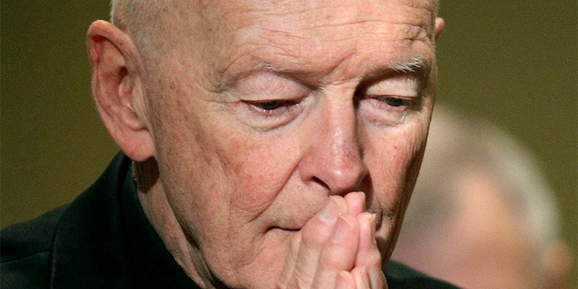 Former Cardinal Theodore McCarrick prays during the United States Conference of Catholic Bishops' annual fall assembly in Baltimore in 2011.