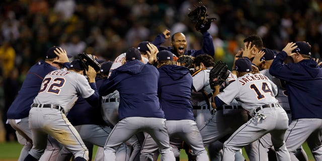 The Detroit Tigers celebrate after beating the Oakland Athletics 3-0 in to win Game 5 of an American League baseball division series in Oakland, Calif., Thursday, Oct. 10, 2013. (AP Photo/Marcio Jose Sanchez)