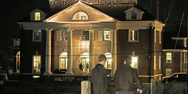 """FILE - Students participating in rush pass by the Phi Kappa Psi house at the University of Virginia in Charlottesville, Va., in this Jan. 15, 2015 file photo. Now the Columbia Graduate School of Journalism is about to explain how it all went so wrong. The school's analysis of the editorial process that led to the November 2014 publication of """"A Rape on Campus"""" will be released online at 8 p.m. EDT Sunday April 5, 2015. (AP Photo/Steve Helber, File)"""