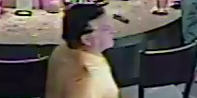 This unidentified man is being sought for allegedly pulling a woman's hijab while at a restaurant in New Hampshire.