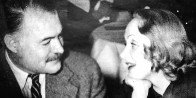 Marlene Dietrich with Ernest Hemingway.