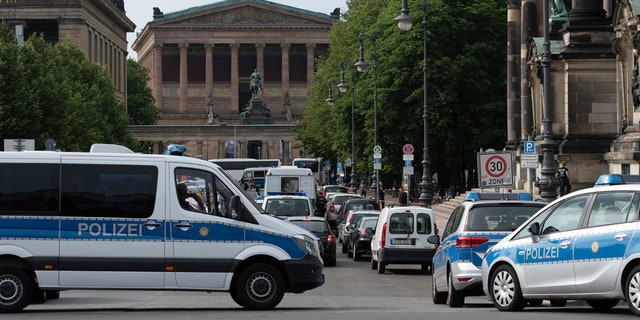 Police vehicles stand in front of Berlin Cathedral, Sunday June 3, 2018.