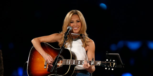 """Musician Sheryl Crow performs """"Boots of Spanish Leather"""" at the 2015 MusiCares Person of the Year tribute honoring Bob Dylan in Los Angeles, California February 6, 2015."""