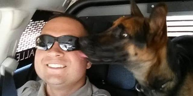 Abbie pictured with her handler, Deputy Eliseo Ramos.