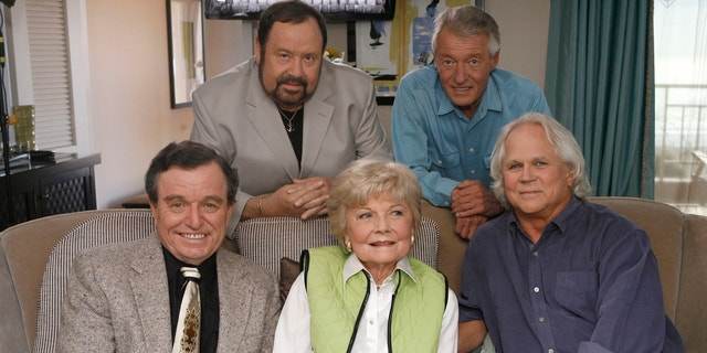 """In this Sept. 27, 2007 file photo, seated, from left, Jerry Mathers, Barbara Billingsley and Tony Dow, and, standing from left, Frank Bank and Ken Osmond, pose for a photo as they are reunited to celebrate the 50th anniversary of the television show, """"Leave it to Beaver,"""" in Santa Monica, Calif."""