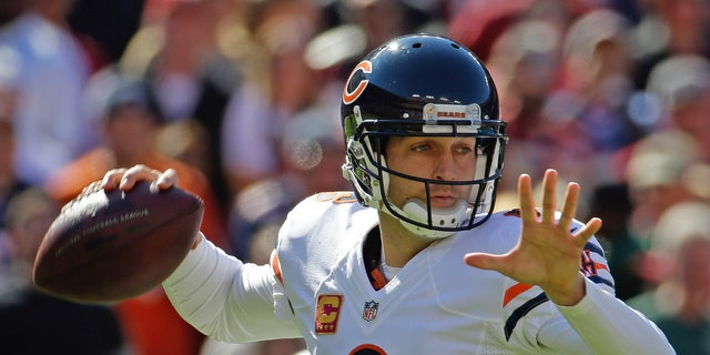 Chicago Bears quarterback Jay Cutler passes during the first half of a NFL football game against the Washington Redskins in Landover, Md., Sunday, Oct. 20, 2013. (AP Photo/Alex Brandon)