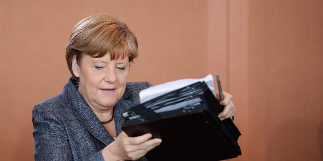 German Chancellor Angela Merkel arrives for the beginning of German government's weekly cabinet meeting at the chancellery in Berlin, Germany, Wednesday, June 3, 2015. (AP Photo/Markus Schreiber)