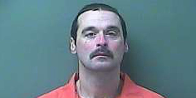 This Monday, Feb. 3, 2014 image provided by the LaPorte County Sheriff's office shows escaped prisoner Michael David Elliot. Elliot, a convicted killer who peeled a hole in two fences with his hands to escape from the Ionia Correctional Facility in western Michigan before abducting a woman and fleeing to Indiana was captured Monday evening after a chase, authorities said. (AP Photo/LaPorte County Sheriff's Office)