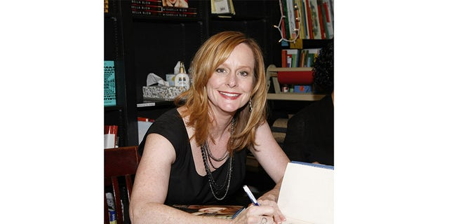 Mary McDonough signing books for fans.