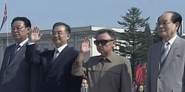 Oct. 4: Chinese Premier Wen Jiabao, second from left, and North Korean leader Kim Jong Il wave to well wishers upon Wen's arrival in Pyongyang.
