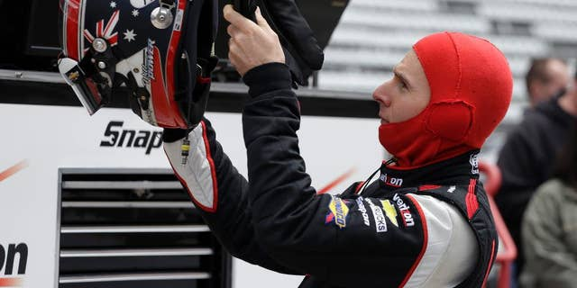 Driver Will Power, of Australia, prepares to drive during practice for Indianapolis 500 IndyCar auto race at the Indianapolis Motor Speedway in Indianapolis, Friday, May 16, 2014. (AP Photo/Darron Cummings)