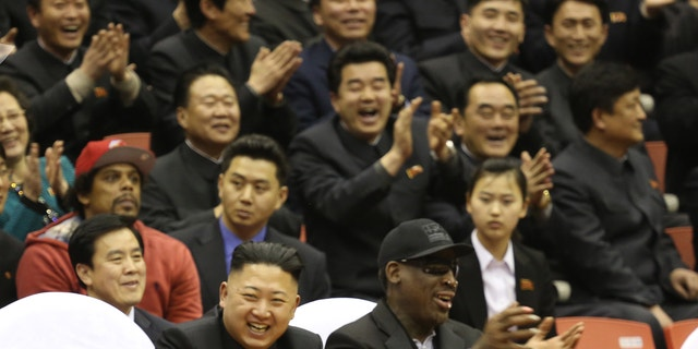 Kim Jong Un and Dennis Rodman watch North Korean and U.S. players in an exhibition basketball game at an arena in Pyongyang, North Korea, in 2013. (AP Photo/VICE Media, Jason Mojica, File)