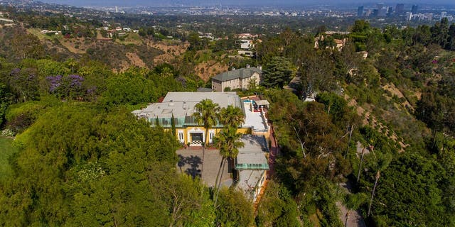 The eventual buyer has the option to either restore the lavish 1950s estate or tear down and rebuild it into a 24,020 private compound with pre-approved permits.