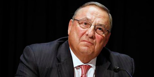 FILE- In this June 7, 2016, file photo, Maine Gov. Paul LePage attends an opioid abuse conference in Boston. LePage is being accused again of making racially insensitive comments, this time by saying photos he's collected in a binder of drug dealers arrested in the state show more than 90 percent of them are black or Hispanic. The governor made the remark at a town hall in North Berwick, Maine, Wednesday, Aug. 24, 2016. (AP Photo/Michael Dwyer, File)