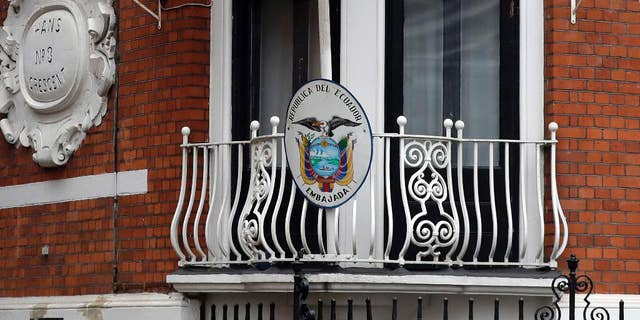 The Ecuadorian flag flies outside the Ecuadorian Embassy in London, where Julian Assange is fighting new restrictions on his activities. (AP Photo/Kirsty Wigglesworth)