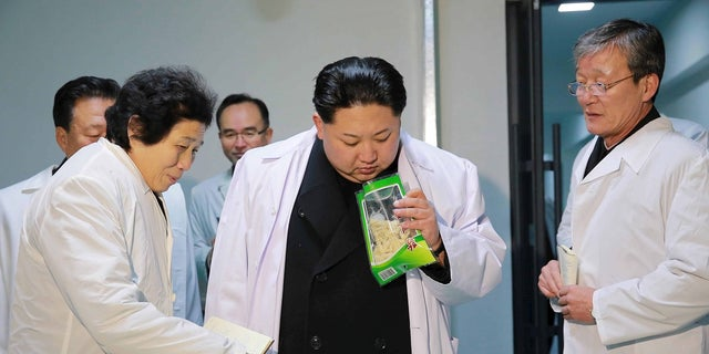 Kim Jong Un visits the Kumkop General Foodstuff Factory for Sportspersons.