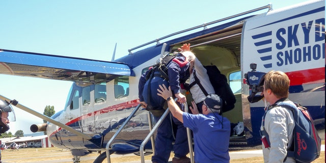 Enjoying the day with family and new friends, Williamson bravely boarded a Skydive Snohomish plane.