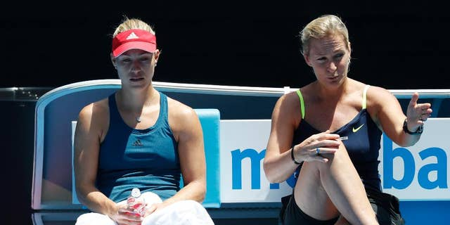 Germany's Angelique Kerber, left, listens to her coach Barbara Rittner during a practice session ahead of the Australian Open tennis championships in Melbourne, Australia, Sunday, Jan. 15, 2017. (AP Photo/Kin Cheung )