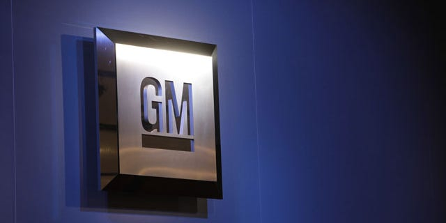 FILE - In this Jan. 12, 2009 file photo, the General Motors logo is on display at the North American International Auto Show in Detroit.  (AP Photo/Paul Sancya, File)