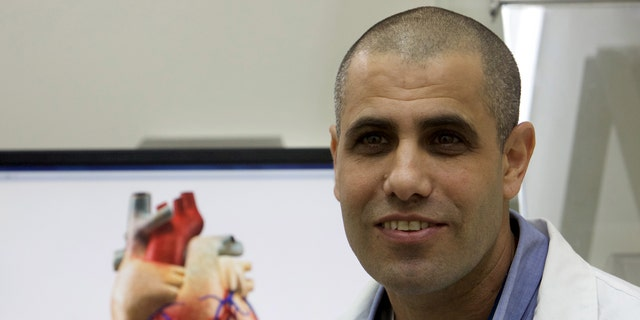 File photo: Professor Tal Dvir speaks during their interview with Reuters on his team's development of a 3D printed patch comprised of lab-grown heart tissue and nano-electronics that could potentially revolutionize the treatment of heart disease, at a laboratory in Tel Aviv University March 16, 2016. Picture taken March 16, 2016. (REUTERS/ Nir Elias)