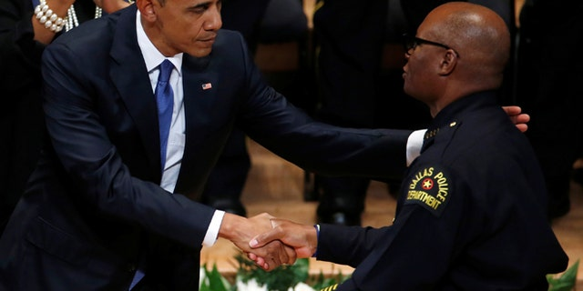 President Obama shakes hands with Dallas police chief David Brown during a memorial service following the multiple police shootings in Dallas