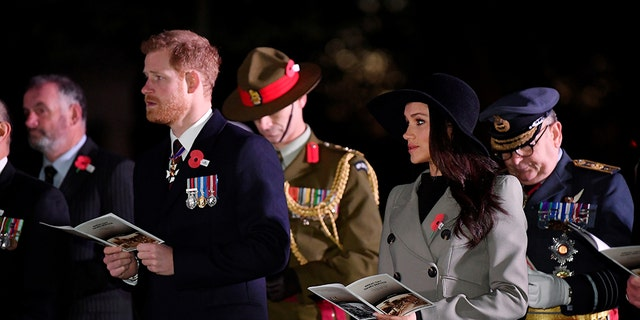 Prince Harry and Markle at Anzac Day, honoring Australians and New Zealanders who served or died in wars.
