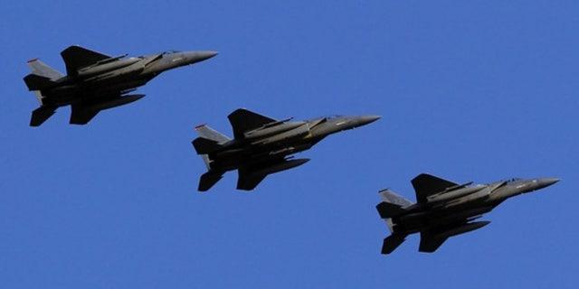 Feb. 25: U.S. Air Force F-15 Eagle fighter jets fly over Kadena Air Base in Japan.