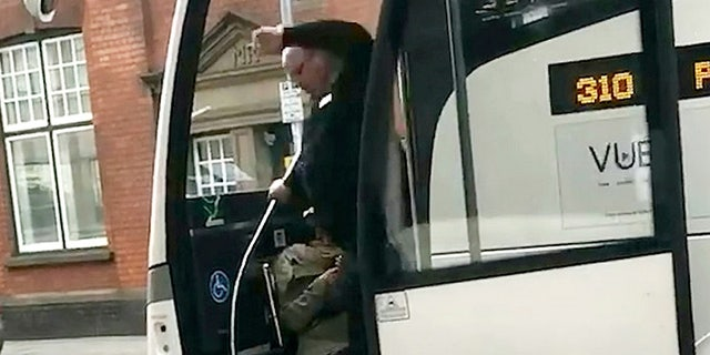 Mobile footage filmed by another passenger captured the moment the National Express driver hauled the woman down the steps of the coach.